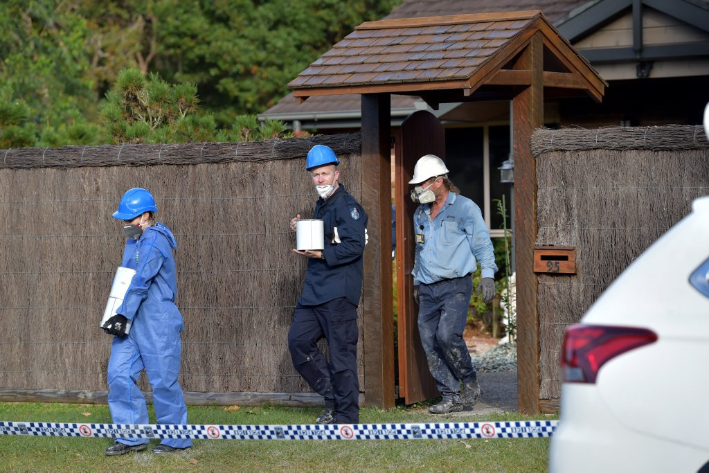 Investigators outside the fatal house fire in Coolum.