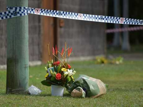 Flowers lay in front of the home where Coolum State School teacher Kylie Allen was fatally injured in a house fire.