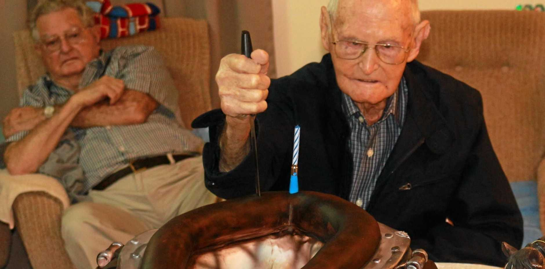 HORSEMAN: After a lifetime working with horses, Alby Cross had two cakes, a harness collar and a saddle to celebrate his 100th birthday.