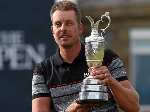 MAJOR BREAKTHROUGH: Henrik Stenson of Sweden holds the Claret Jug for winning the British Open Golf Championship at Royal Troon in Scotland.