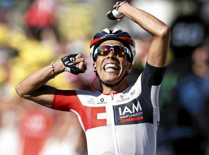FIRST WIN: IAM Cycling team rider Jarlinson Pantano (left) of Colombia celebrates after winning the 15th stage of the Tour de France over 160km between Bourg-en-Bresse and Culoz Villars-Les-Dombes Parc des Oiseaux.