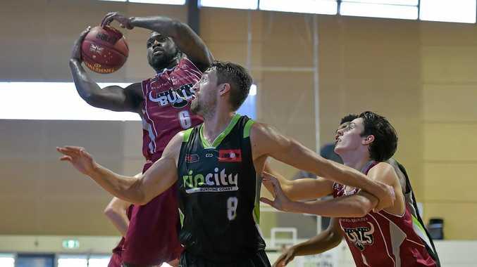 Bundaberg Bull Sheraun King fights for the ball against the Sunshine Coast Rip