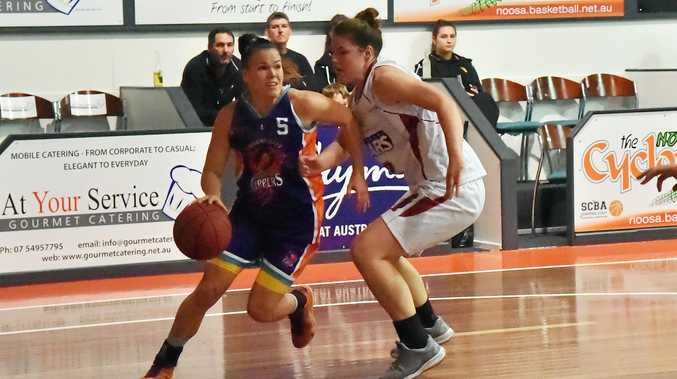 MARKER: Bundaberg's Christina Boag tries to steal the ball from Clippers player Katarina Flasaroval.