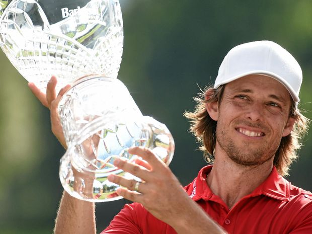 CRUCIAL WIN: Australian Aaron Baddeley holds up his trophy after winning the Barbasol Championship.