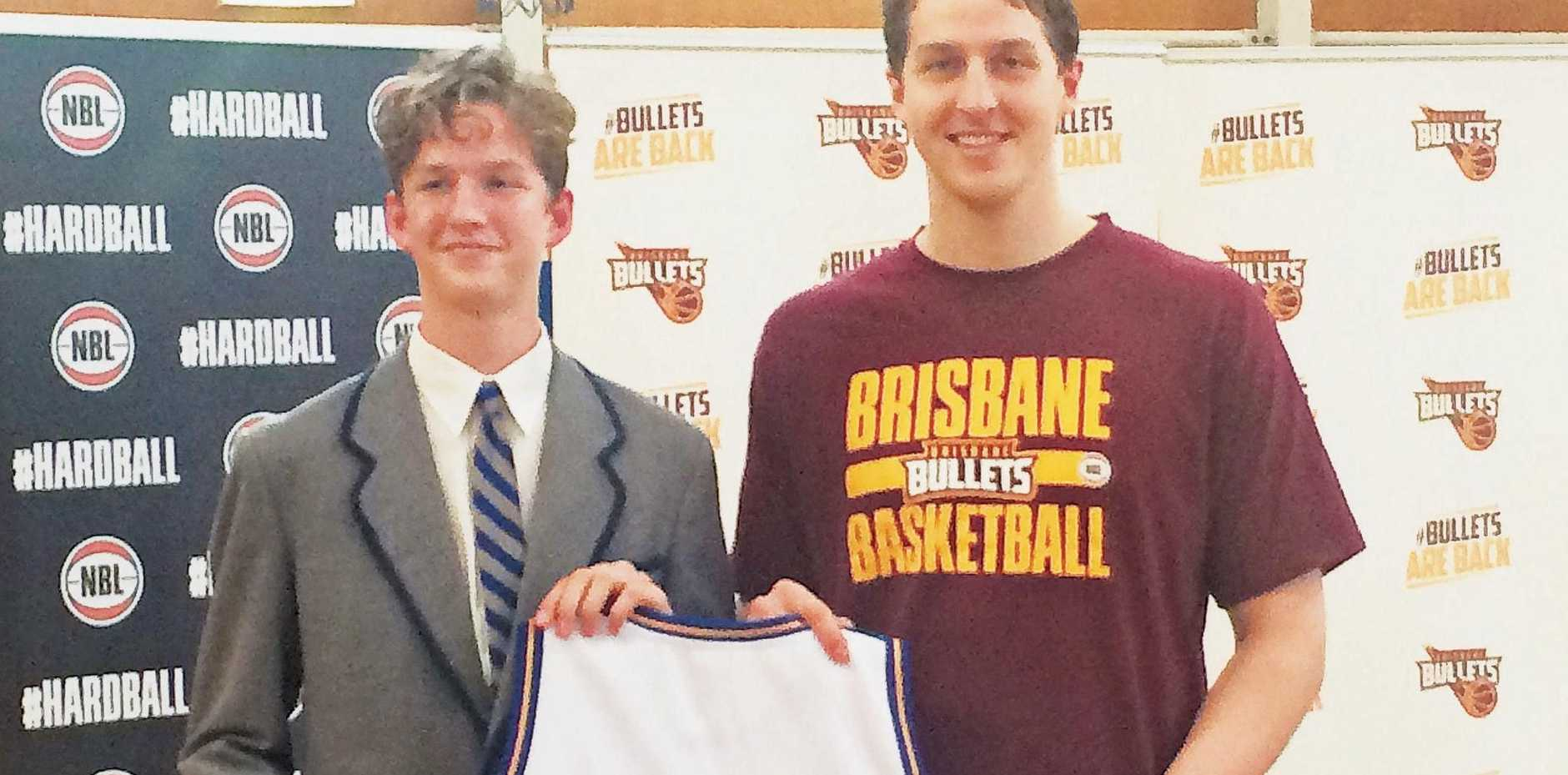 WELCOME HOME: Cameron Bairstow is presented with his Bullets playing singlet by his younger brother, Sean, at his former school, Anglican Church Grammar (Churchie), in Brisbane.