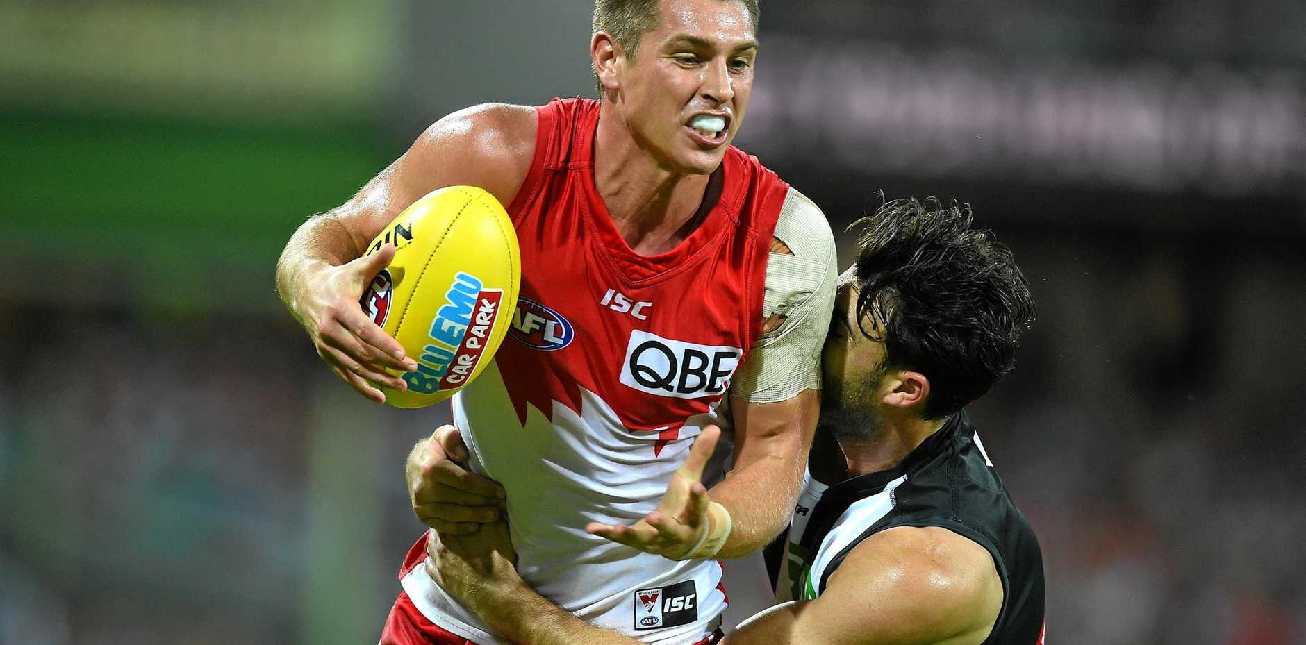 COURT DATE: Michael Talia of the Swans is tackled by Alex Fasolo of the Magpies during round one this year.