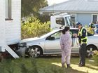 Emergency services attend to a two-vehicle crash where one of the vehicles ran into a house in Farquharson St, Harristown, Tuesday, July 19, 2016.