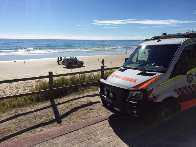 Emergency services working on patient on a Byron Bay beach.