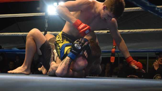 Mackay MMA's Peter Templer secures the mount and damages opponent Jake Gunston at Airlie Fight Night Five.