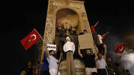 Protesters carry an effigy of Turkish Muslim cleric Fethullah Gulen, founder of the Gulen movement, during a demonstration at Taksim Square, in Istanbul, Turkey, 18 July 2016. Gulen has been accused by Turkish President Recept Tayyip Erdogan of allegedly orchestrating the 15 July failed coup attempt.