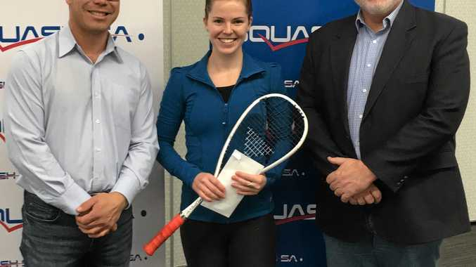 Squash SA's CEO Phil Sinnott (left) and Campbelltown Mayor Simon Brewer present Coffs Harbour squash player Tamika Saxby with her prize for winning the South Australian Open.