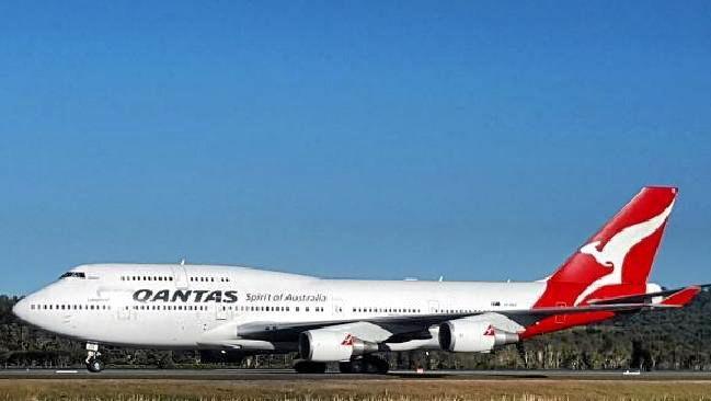 The Qantas jumbo on the runway at Gold Coast Airport.
