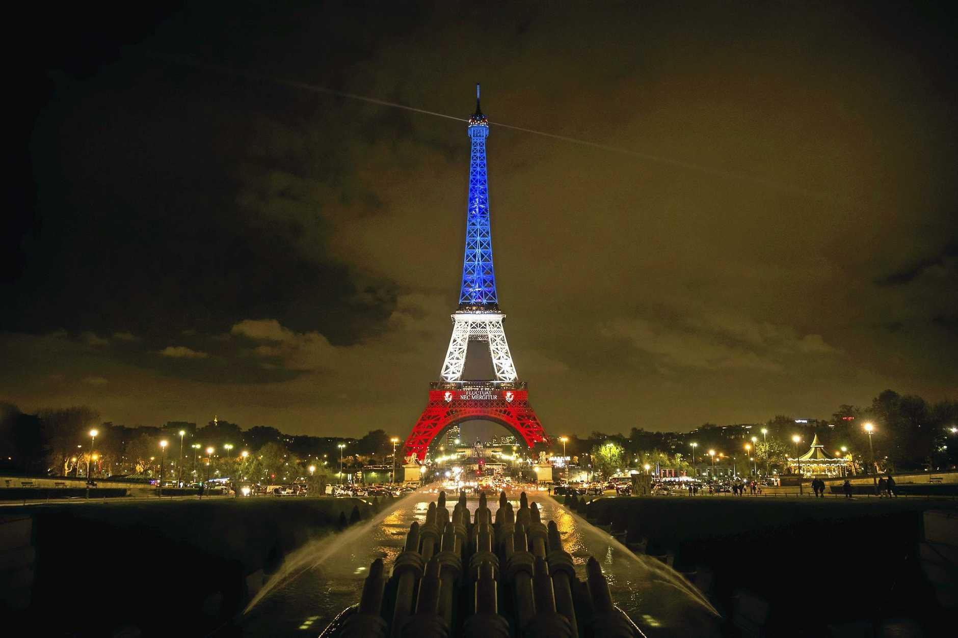 epaselect epa05028805 The Eiffel Tower is illuminated in the colors of the French flag in tribute for the victims of the 13 November terror attacks, in Paris, France, 16 November 2015. At least 132 people were killed and some 350 injured in the terror attacks on 13 November, which targeted a concert venue, a sports stadium, and several restaurants and bars in Paris. Authorities believe that three coordinated teams of terrorists armed with rifles and explosive vests carried out the attacks, which the Islamic State (IS) extremist group has claimed responsibility for.  EPA/ETIENNE LAURENT
