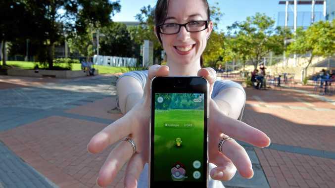 CATCH 'EM ALL: Alayna Cole hunts Pokemon ahead of USC's first Poke-walk.
