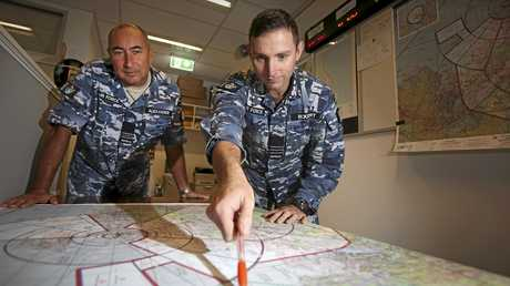Commanding Officer Combat Control Support Centre, Wing Commander Paul Rickert (right) and Executive Officer Squadron Leader James Alexander review plans for exercise Pitch Black.