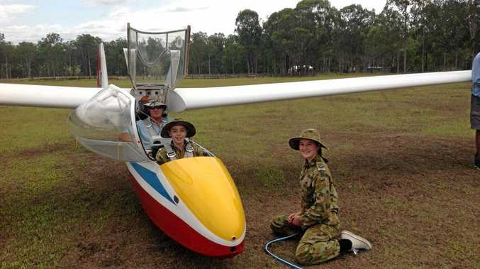 Coffs Harbour Air Force Cadet Nicholas Winkler and Cadet Corporal Jemma Coad with Graham Davis of Grafton Gliding Club
