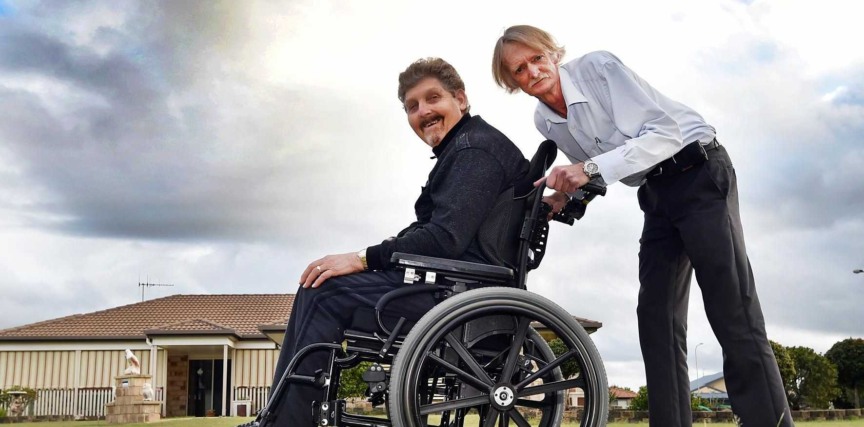 FOOTPATHS ON THE AGENDA: Carer Kenneth Sengstock pushes client Russell Dreger along the road near his home.