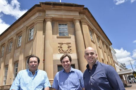 The former Westpac Bank will be transformed. In front of the building (from left) are Philip Collins, John Collins and Markus Eames.