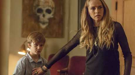 Gabriel Bateman and Teresa Palmer in a scene from the movie Lights Out.