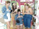 These young women are four of millions of people hooked on the latest mobile app, Pokemon Go. Pictured in Kaboozies store in James St Yeppoon, which has been recieving more trading than usual as a result of the virtual game. Photo Contributed / The Capricorn Coast Mirror