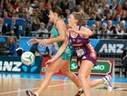 TOUGH DEFENCE: Queensland Firebirds player Gabi Simpson (right) and Melbourne Vixens player Madi Robinson in action during the 2014 grand final.