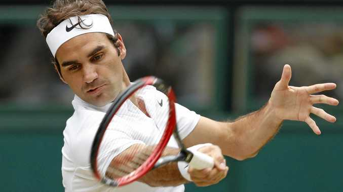 RIO DREAMS: Roger Federer of Switzerland returns a shot against Canadian Milos Raonic in the semi-finals of the Wimbledon tennis tournament in London.