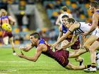 UNITED FRONT: Tom Rockliff of the Lions gets a handball away.