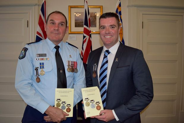 Sergeant Paul Andrews and Senior Constable Matthew Shillingford receive a bravery award for their work during the Grantham floods in 2011.Photo Pamela Frost