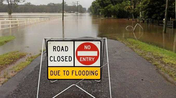 Stock image of a flooded road on the Sunshine Coast.