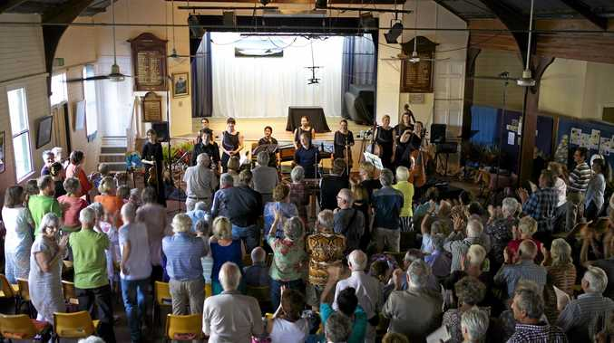 Crowds enjoying a past Tyalgum Music Festival in the historic hall, famed for its acoustics.