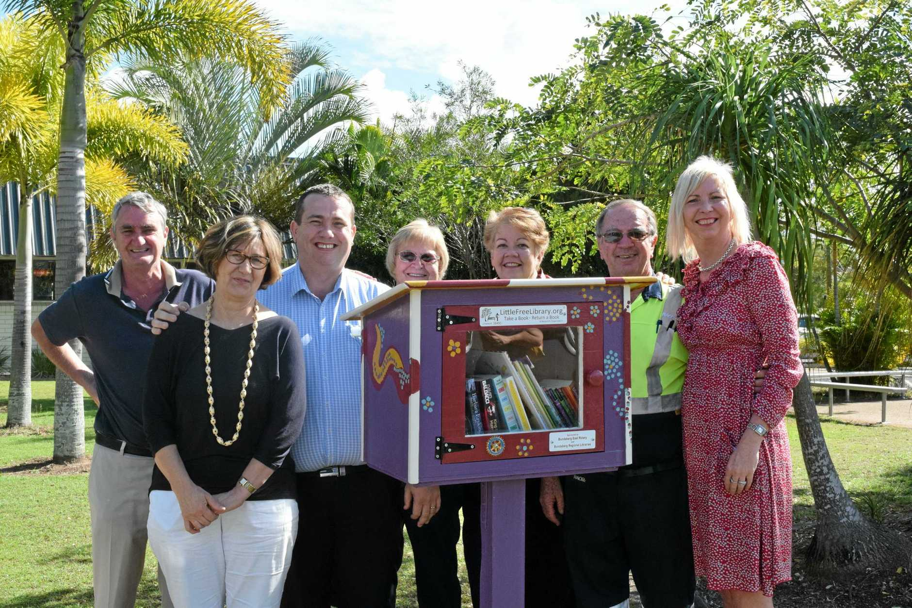 LIBRARY LAUNCH: Rod Medew, Cathy Zanella, Brant Duff, Jan Mylrea, Sue Gammon, Ian Mylrea and Maria Burnet launch the Little Free Library at the YMCA. Photo: Eliza Goetze / NewsMail