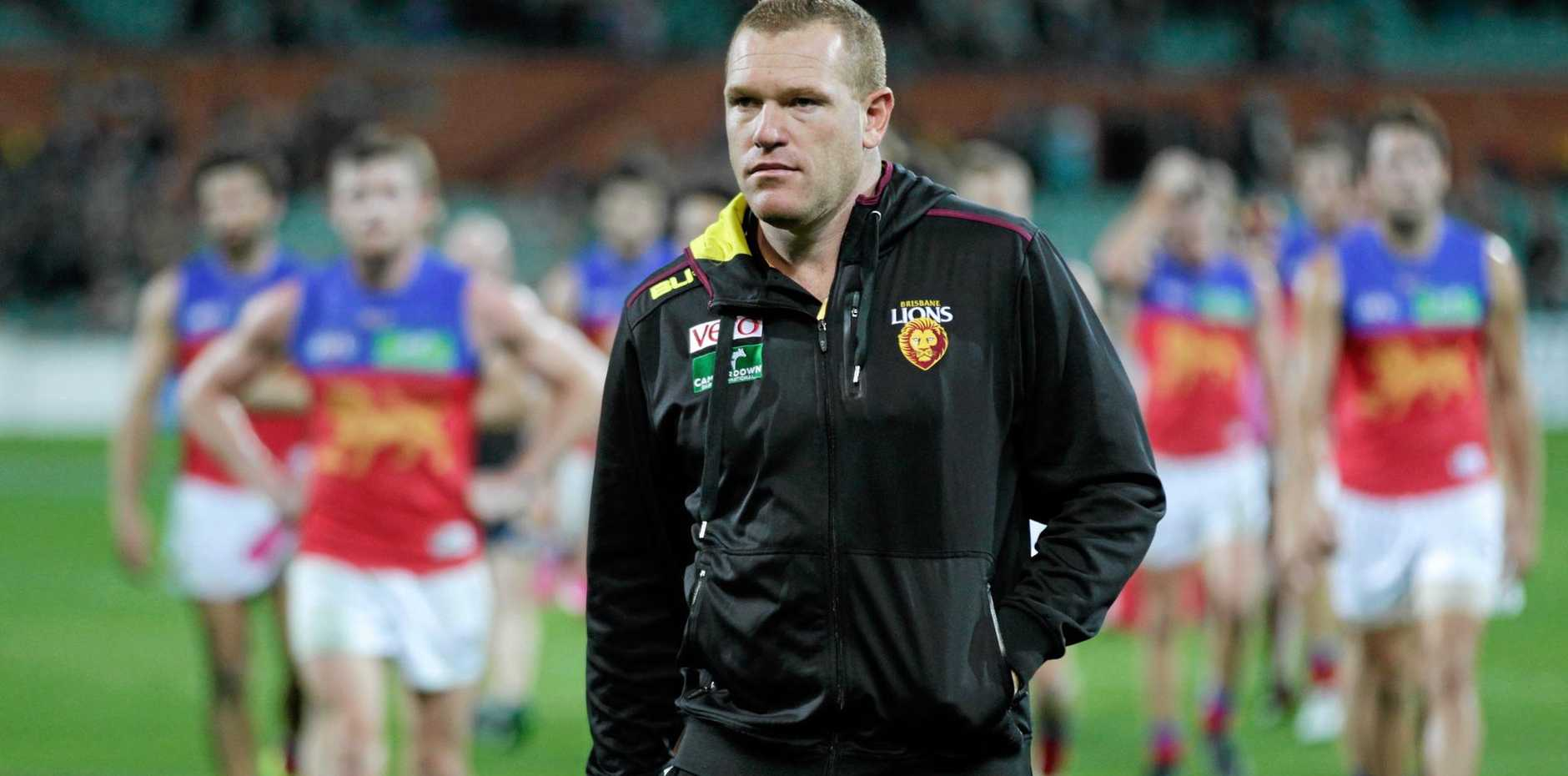 UNDER PRESSURE: Brisbane Lions coach Justin Leppitsch leads his players off after another defeat this year.