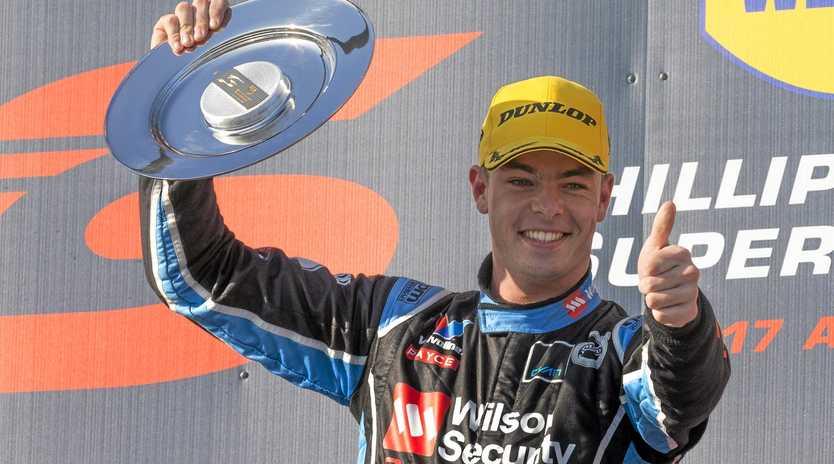 YOUNG GUN: Scott McLaughlin of Garry Rogers Motorsport celebrates winning the WD-40 Phillip Island SuperSprint in April 17.