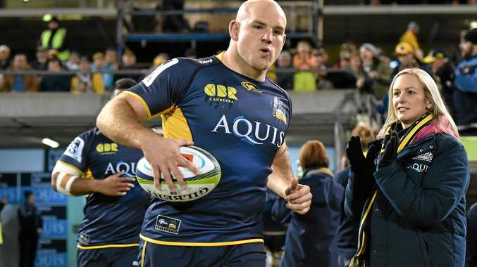 FINALS CLASH: Brumbies skipper Stephen Moore leads out his team.