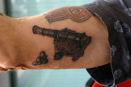 GREAT FIND: Warren Rowlands shows his cannonball tattoo.