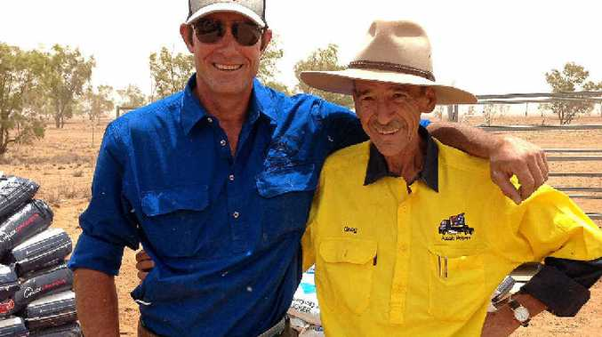 HELPING HAND: Farmer Grant Wells with Aussie Helpers co-ordinator Greg Pearson.
