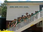 STILL GOING STRONG: Students of Burra Burri State School with principal Janet Baldock in 2011.