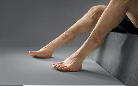 Graham's grasshopper-like legs, with an additional joint above the ankle and highly flexible knees.