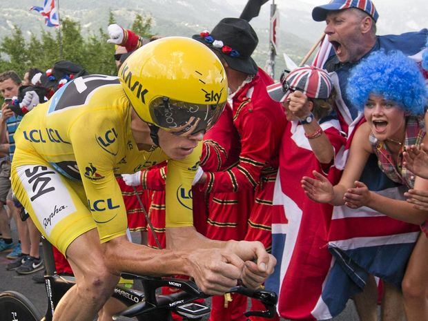 CRUISE CONTROL: Britain's Chris Froome, wearing the overall leader's yellow jersey, climbs during the 18th stage of the Tour de France cycling race, an individual time trial over 17km.