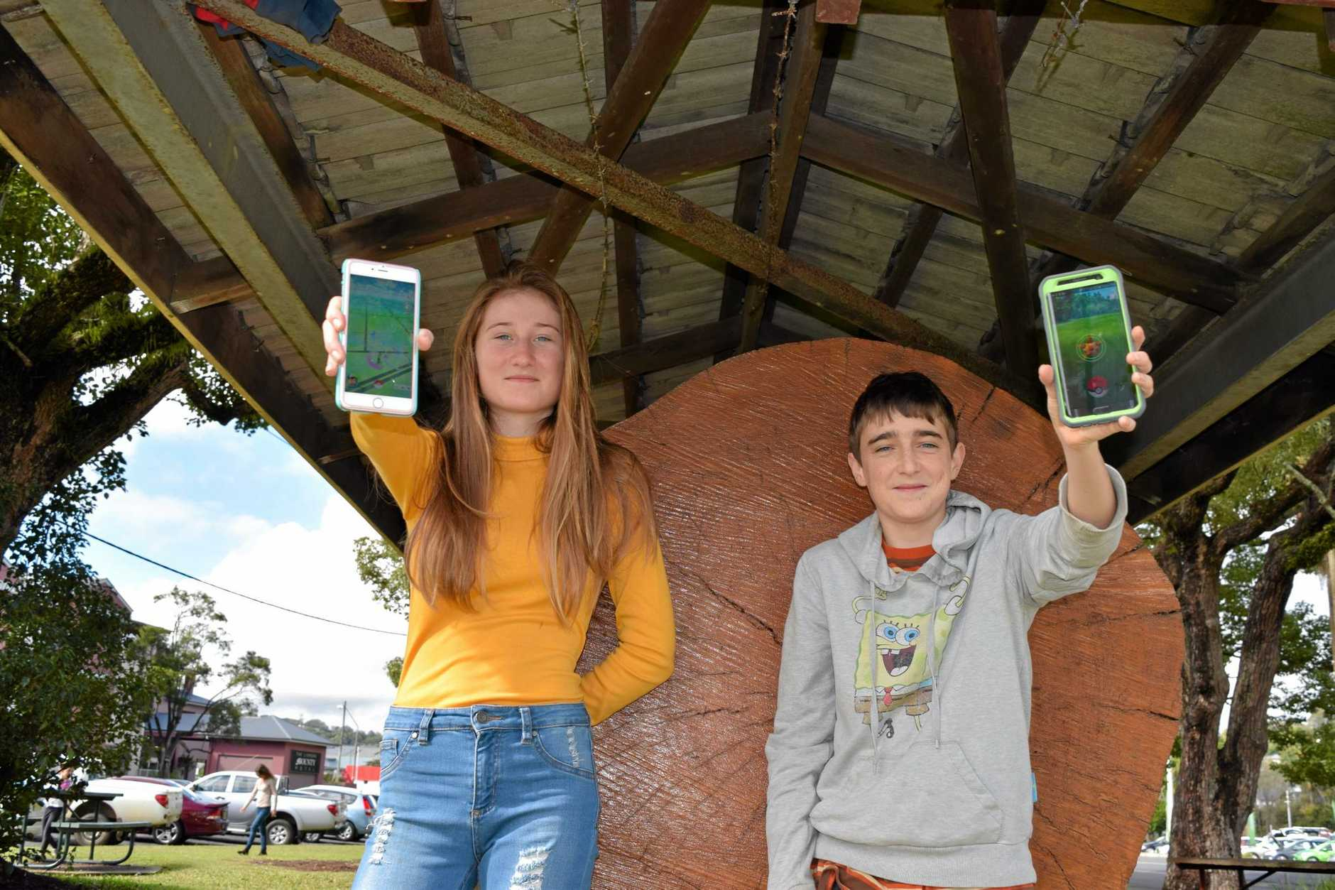 Siblings Maya and Tommy Collinson playing Pokémon Go at the Cedar Log, Lismore
