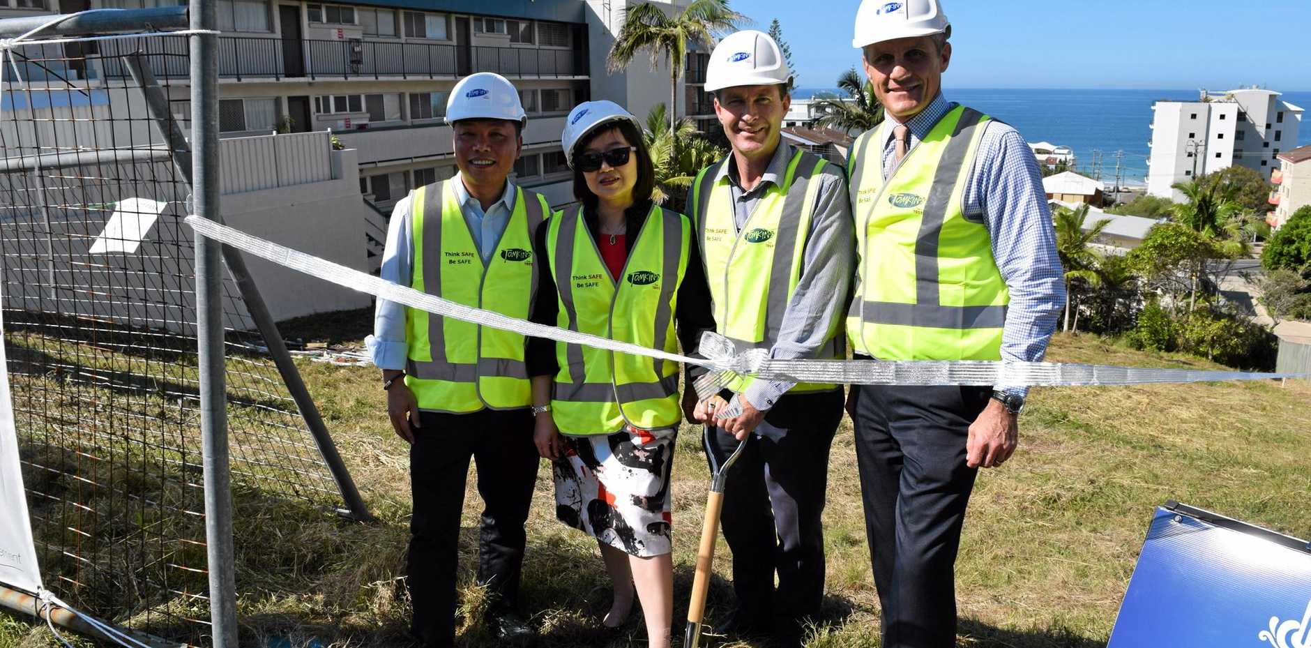 Turning the first sod at the Aqua View Apartments site in Kings Beach are (from left) husband-and-wife developers Alex Yuan and Stella Sun with construction company Tomkins director Mike Tomkins and Councillor Tim Dwyer.