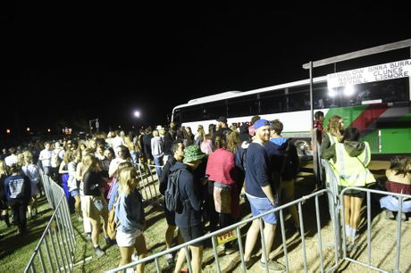 Punters at Splendour lineup at the bus stop to leave the festival site. Photo Marc Stapelberg / The Northern Star