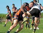 DEFENCE: Wests Tigers winger James Dean Jacques delivers a crunching tackle to stop a try.