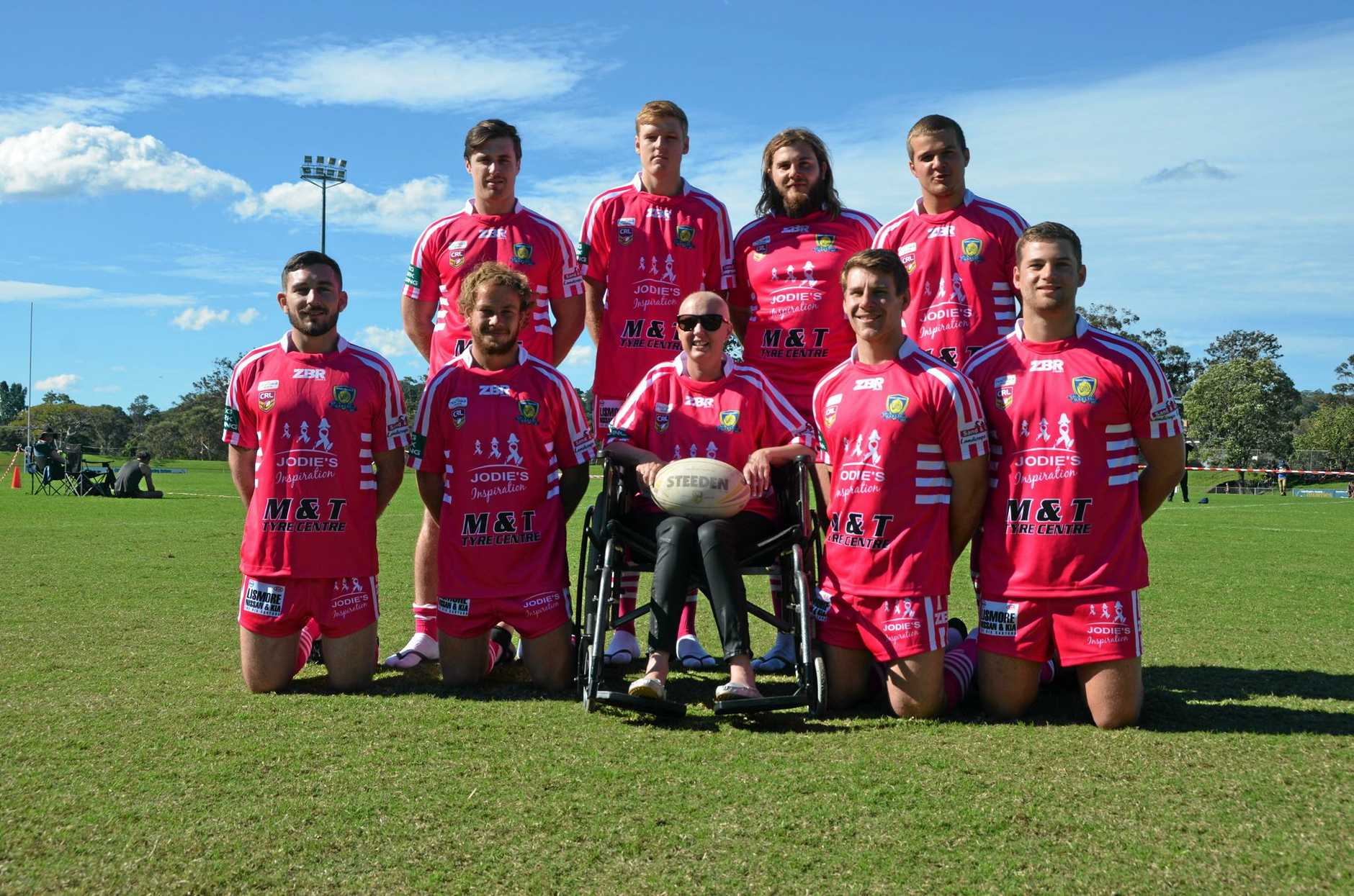 The Marist Brothers Rams wore pink to support Jodie McRae (centre) and her charity, Jodie's Inspiration, at the Rugby League Football Club Day on the weekend.