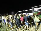 Festival goers wait in line for a bus home after attending the Splendour in the Grass music festival.