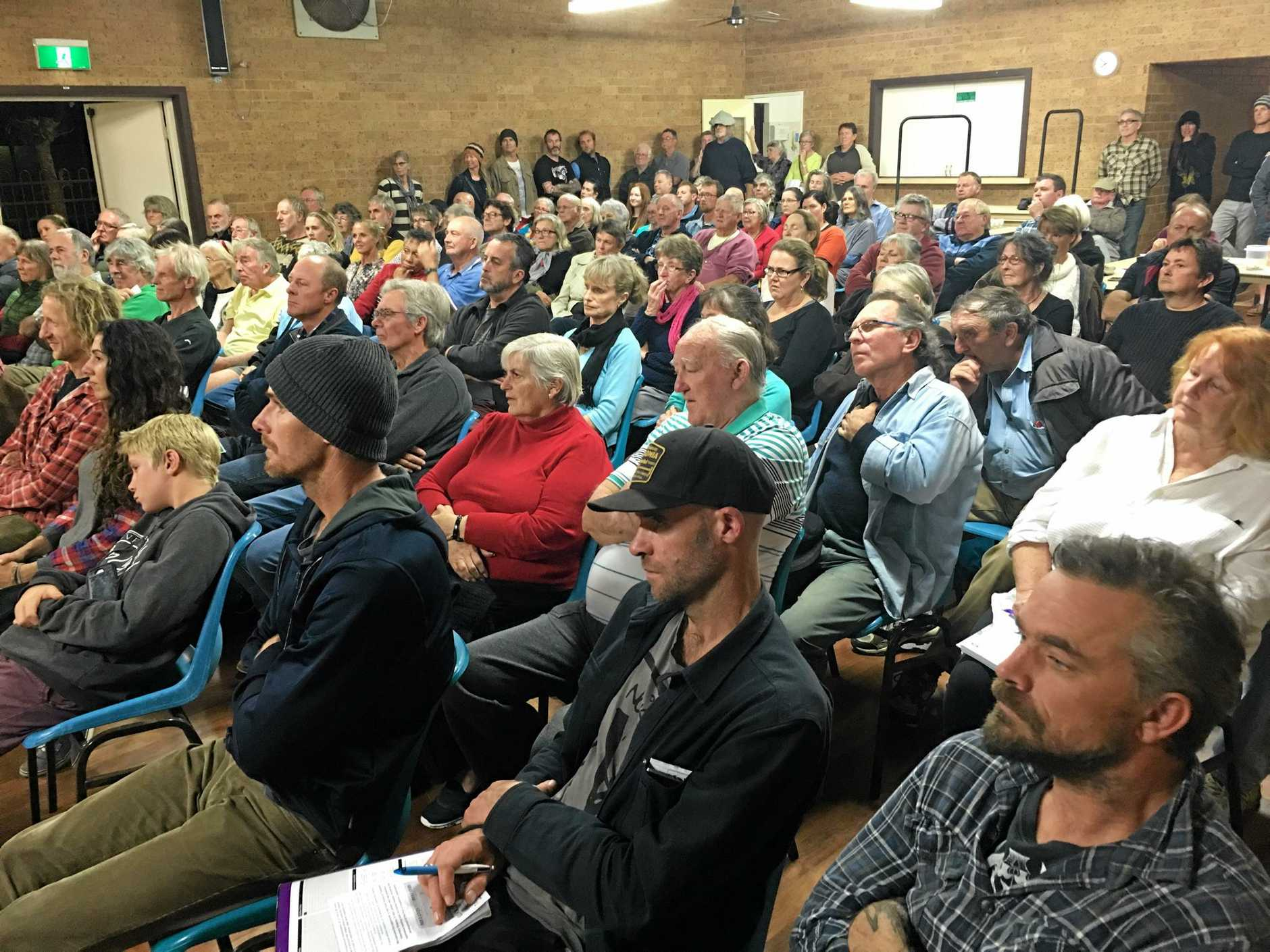 STORM OVER PORT: The crowd at the Iluka Community Hall meeting listens to concerns about plans for a major port development at Yamba.