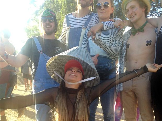 Amberly Nelson, from Melbourne, posts for a photo with friends at Splendour in the Grass.