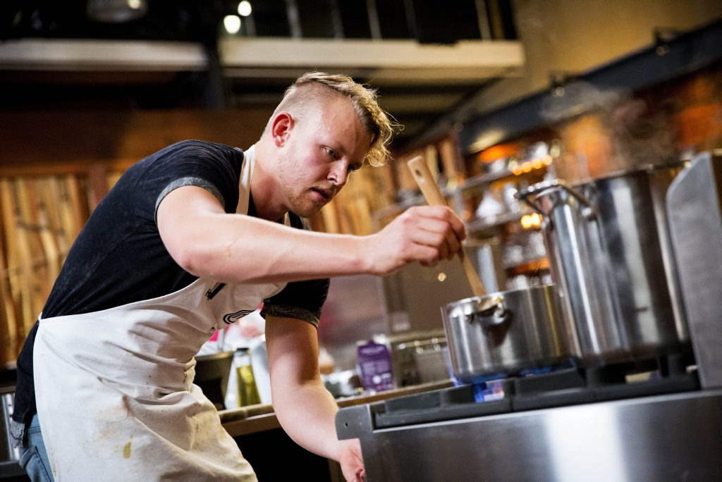 Harry Foster pictured cooking during tonight MasterChef semi-final service challenge.