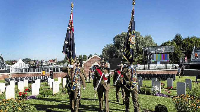 SPECIAL: Australian soldiers from the 31st/42nd Battalion, Royal Queensland Regiment, march on the 31st Battalion Colours at Pheasant Wood Military Cemetery on July 19.