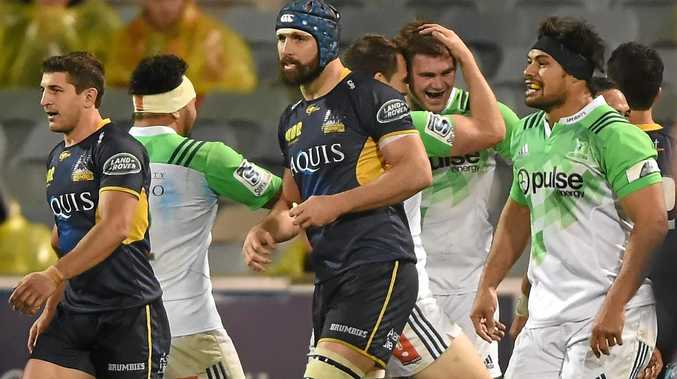 MARCHING ON: The Highlanders celebrate Tom Franklin's try during their Super Rugby quarter-final match against the ACT Brumbies.